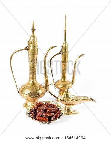 Arabic traditional dishes pots and dates fruits. Holidays decoration. Eid mubarak. Ramadan kareem