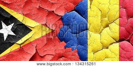 east timor flag with Romania flag on a grunge cracked wall