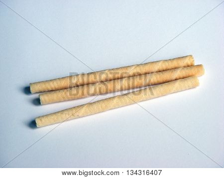 Waffer rolls with vanilla cream withe isolated