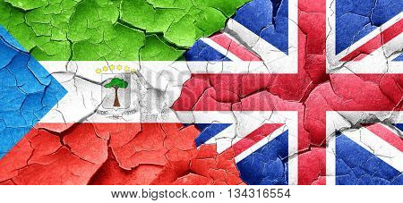 Equatorial guinea flag with Great Britain flag on a grunge crack