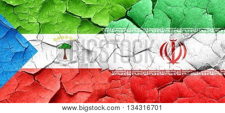 Equatorial guinea flag with Iran flag on a grunge cracked wall