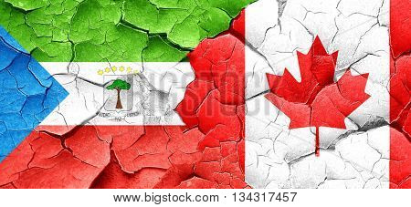 Equatorial guinea flag with Canada flag on a grunge cracked wall