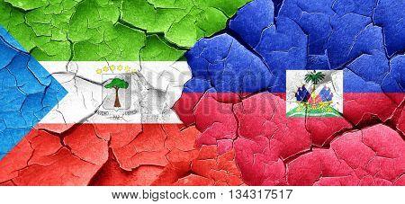 Equatorial guinea flag with Haiti flag on a grunge cracked wall