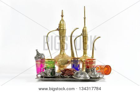 Arabic traditional dishes and decorations. Holidays composition with dates fruits. Oriental hospitality concept. Tea table. Ramadan kareem