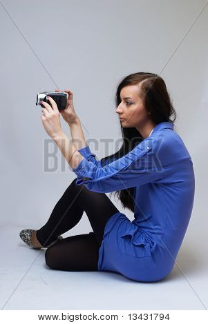 Young woman with camera