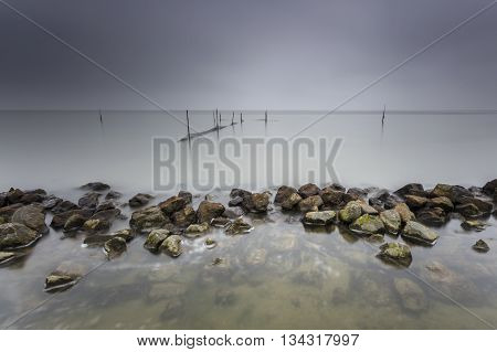 Lake Fishnets In Long Exposure With Moody Sky