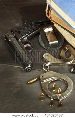 Police gun and badge. Weapons to defend law and order. The right to own a gun. Defense Law. Crime and Punishment.