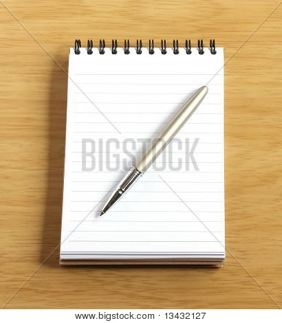 Notebook And Pen On Wooden Desk