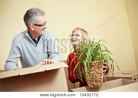 Senior People Packing Moving Boxes