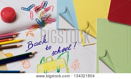 School start time. Back to school, background with pencils, notebooks and picture