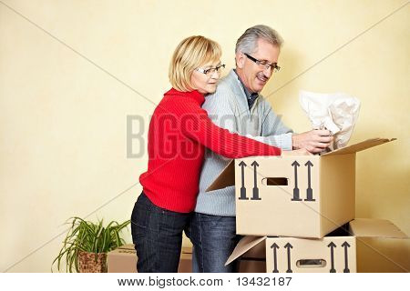 Senior People Searching In Moving Box