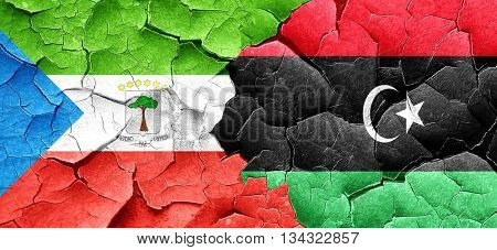 Equatorial guinea flag with Libya flag on a grunge cracked wall