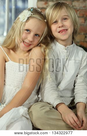 Children - smiling sibling sister and brother