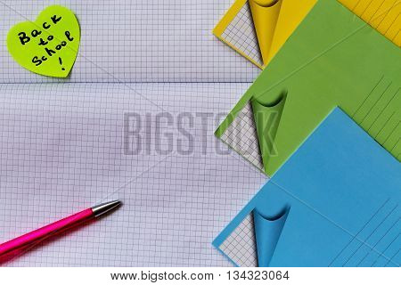 School start times. Pen, notebook and reminder Back to School on a blank sheet. With your place for the text.