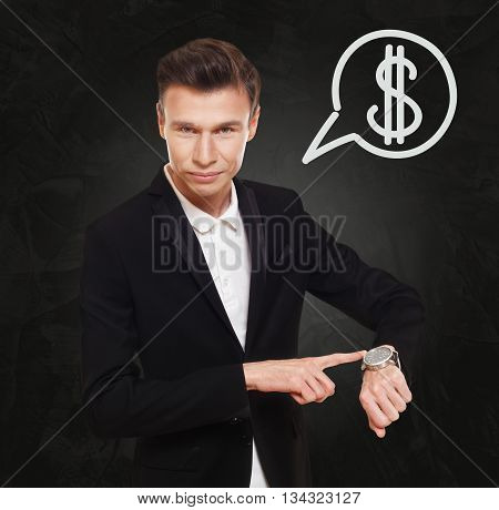 Time is money. Businessman point at his watch showing time is money concept. Man in suit with watch at black background, thinking cloud with dollar sign. Work and earn, business, finance.