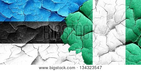 estonia flag with Nigeria flag on a grunge cracked wall