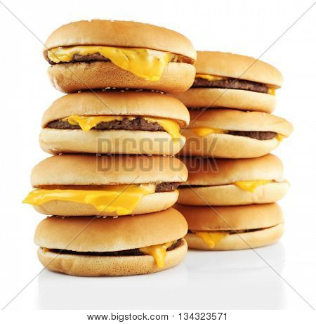 Tasty cheeseburgers, isolated on white