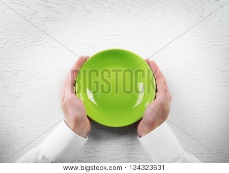 Man holding empty plate. Hunger concept