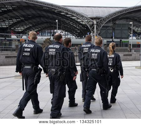 Cologne, North Rhine-Westphalia, Germany - June 12, 2016: Policemen patrolling near Cologne Cathedral and Hauptbahnhof.