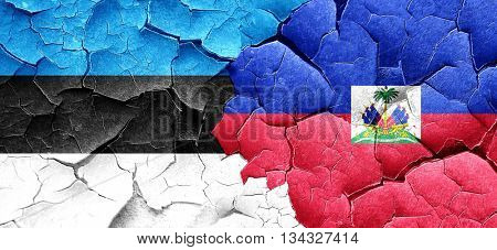 estonia flag with Haiti flag on a grunge cracked wall
