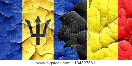Barbados flag with Belgium flag on a grunge cracked wall
