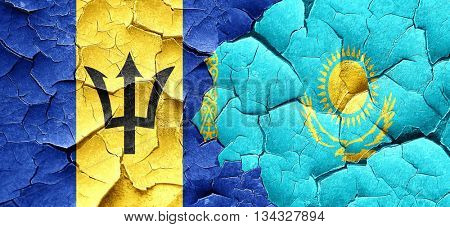 Barbados flag with Kazakhstan flag on a grunge cracked wall