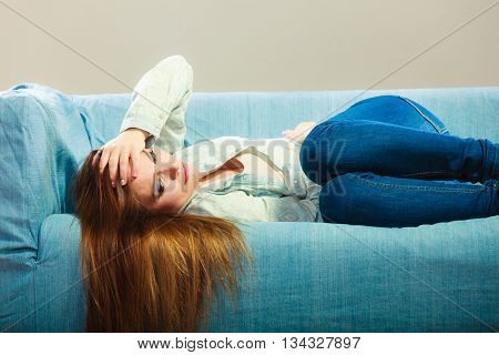 Sad Woman Laying On Couch