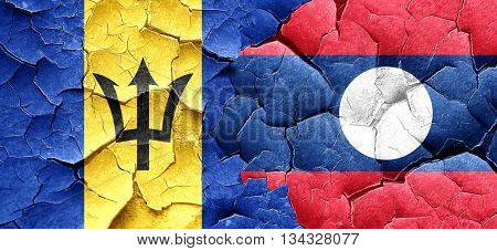 Barbados flag with Laos flag on a grunge cracked wall