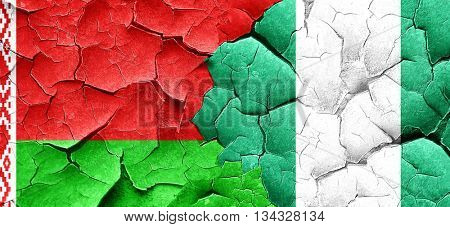 Belarus flag with Nigeria flag on a grunge cracked wall