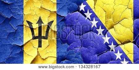 Barbados flag with Bosnia and Herzegovina flag on a grunge crack