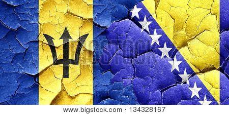 Barbados flag with Bosnia and Herzegovina flag on a grunge crack