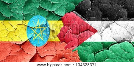 Ethiopia flag with Palestine flag on a grunge cracked wall