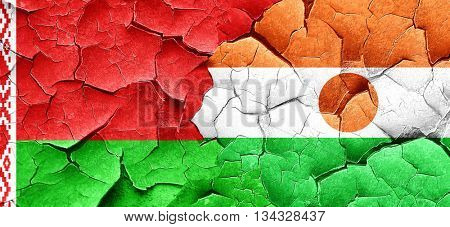 Belarus flag with Niger flag on a grunge cracked wall