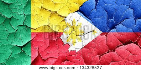 Benin flag with Philippines flag on a grunge cracked wall