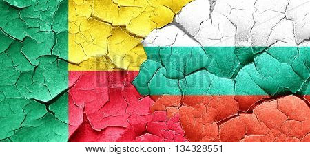 Benin flag with Bulgaria flag on a grunge cracked wall
