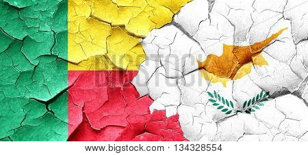 Benin flag with Cyprus flag on a grunge cracked wall