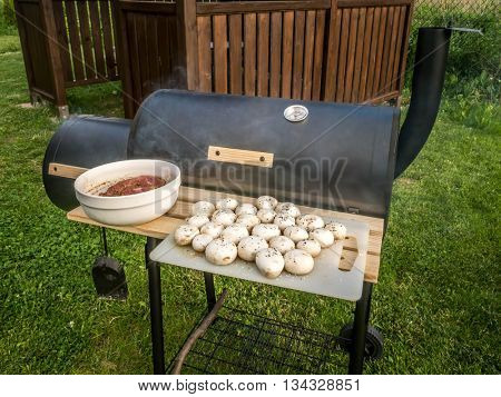 Red meat chops and champignons ready for being placed on barbecue
