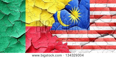 Benin flag with Malaysia flag on a grunge cracked wall