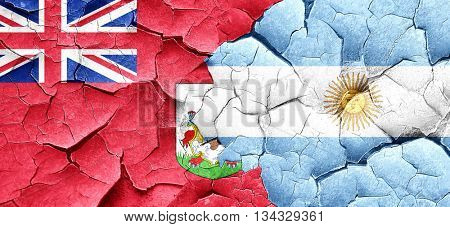 bermuda flag with Argentine flag on a grunge cracked wall
