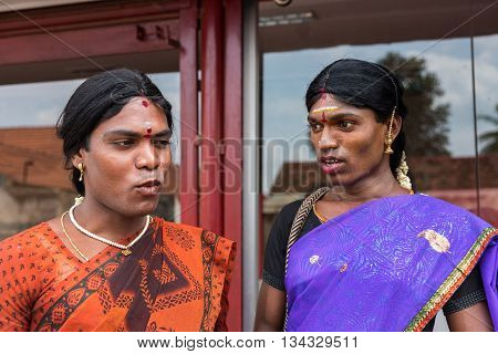Chettinad India - October 17 2013: Portrait of Ms. Abinaja and Ms. Sheila both Hijras transgender persons. Hijras are males who dresses and acts like a woman. Have a sacred status in Hinduism. Dark open faces saris and jewelry. Karaikudi city.