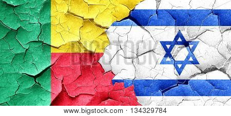 Benin flag with Israel flag on a grunge cracked wall