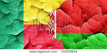 Benin flag with Belarus flag on a grunge cracked wall