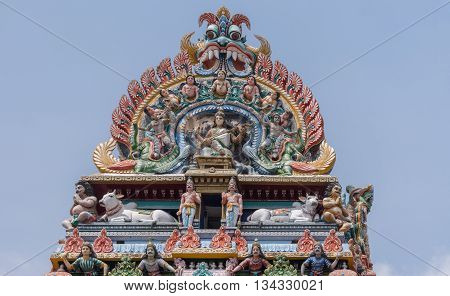 Chettinad India - October 17 2013:Detail of the Shiva temple gopuram at Kottaiyur shows Devi Saraswati playing the Veena with dancers and singers. Plenty of colorful statues.
