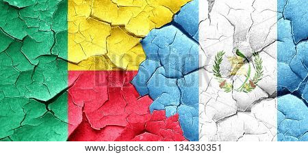 Benin flag with Guatemala flag on a grunge cracked wall