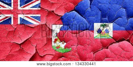 bermuda flag with Haiti flag on a grunge cracked wall