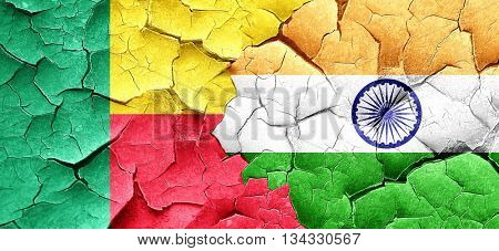 Benin flag with India flag on a grunge cracked wall
