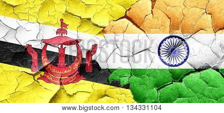 Brunei flag with India flag on a grunge cracked wall