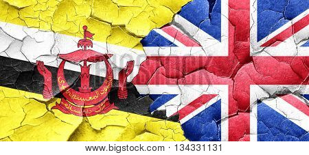 Brunei flag with Great Britain flag on a grunge cracked wall