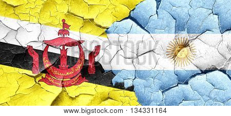 Brunei flag with Argentine flag on a grunge cracked wall
