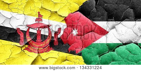 Brunei flag with Jordan flag on a grunge cracked wall